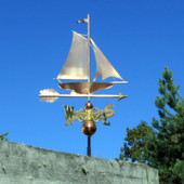 Sailboat Weathervane right side view on blue sky background