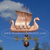 viking ship weathervane right side view on blue sky background