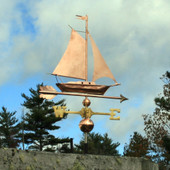 Sailboat Weathervane right angle  side view on cloudy background