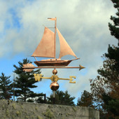Sailboat Weathervane right side view on cloudy background