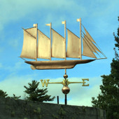 large 4 masted schooner weathervane right side view on blue sky background