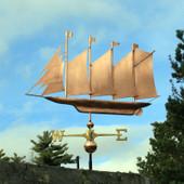 large 4 masted schooner weathervane left side view on blue sky background