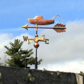 small fishing boat weathervane left side view on cloudy background