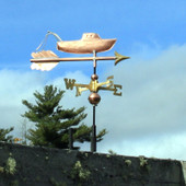 small fishing boat weathervane right side view on cloudy background