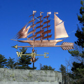 large clipper ship weathervane left side view on blue sky background