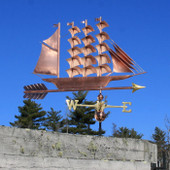 large clipper ship weathervane right side view on blue sky background