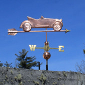 old convertible car weathervane right side view on blue sky background