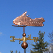 Snowmobile Weathervane left side view on blue sky background