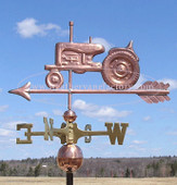 Old Farm Tractor Weathervane left side view on blue sky background