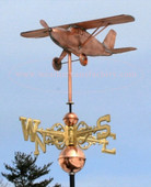 High Wing Airplane Weathervane angle view with scrolled directionals and blue sky background