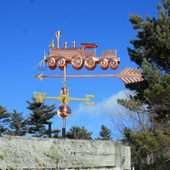 Train Weathervane Left Angle View on Blue Sky Background.