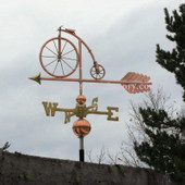 high wheel bicycle weathervane left side view on cloudy sky background