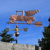 Pickup Truck with Christmas Tree Weathervane left side view on blue sky background
