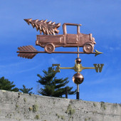 Pickup Truck with Christmas Tree Weathervane right angle side view on blue sky background