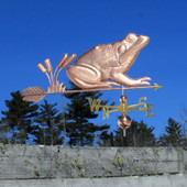 frog with cattails weathervane right side view on blue sky background