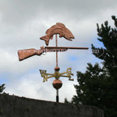 Sportsman Weathervane of gun under a fish right side view on cloudy background
