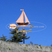 Sailboat Weathervane side view on blue sky background