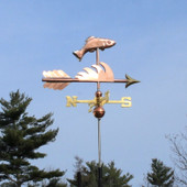 Fish Weathervane right angle view on light blue sky background