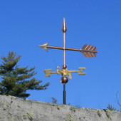 small arrow weathervane side view on blue sky background