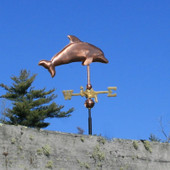 Dolphin Weathervane on blue sky background