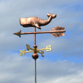 whale weathervane with cloudy background