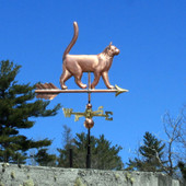 Small Cat Weathervane side view on blue sky background