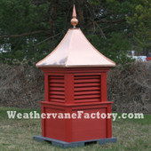 Bedford Louvered Color Cupola shown in red with copper top and copper finial