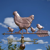 Hen and Chicks Weathervane on a Blue Sky Background.