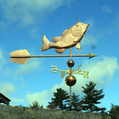 Sun hitting largemouth bass weathervane on cloudy sky background
