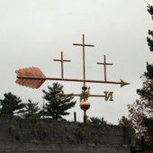Three Crosses Weathervane right side view on  stormy background.
