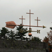 Three Crosses Weathervane right angle view on  stormy background.