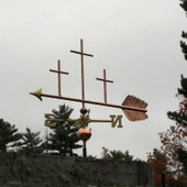 Large Three Crosses Weathervane left side view on  stormy background.