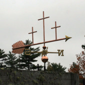 Three Crosses Weathervane right front view on  stormy background.