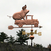 Pig in Pickup Weathervane right side view on stormy sky background.
