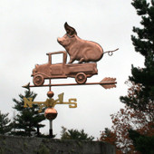 Pig in Pickup Weathervane slight left side view on stormy sky background.