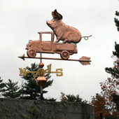 Pig in Pickup Weathervane left side view on stormy sky background.