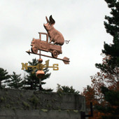 Pickup Truck with Pig Weathervane front view on stormy sky background.