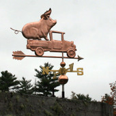 Pickup Truck with Pig Weathervane slight right side view on stormy sky background.