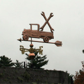 Pickup Truck with Wrenches Weathervane left front view on stormy sky background.