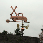 Pickup Truck with Wrenches Weathervane right side view on stormy sky background.