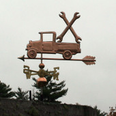 Pickup Truck with Wrenches Weathervane slight left angle view on stormy sky background.
