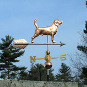 Beagle Weathervane right side view on blue sky background.