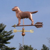 Labrador Weathervane slight left rear view on blue sky background.