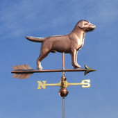 Labrador Weathervane right side view on blue sky background.