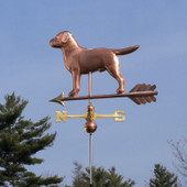 Labrador Weathervane left rear view on blue sky background.