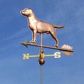 Labrador weathervane slight front view on blue sky background.