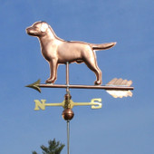 Labrador Weathervane side view on blue sky background.
