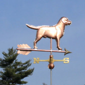 Labrador Weathervane right rear view on blue sky background.