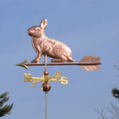 Rabbit Weathervane on blue sky background