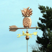Small Pineapple Weathervane slight right side view on light blue sky background.